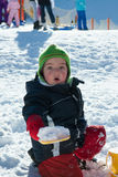 Child playing on the snow Stock Images