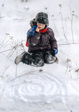Child playing in the snow Stock Photo