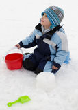 Child playing in snow Stock Photo