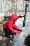 Child playing in the snow Royalty Free Stock Photography