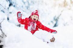Child playing with snow in winter.Boy in snowy park. Royalty Free Stock Photo