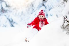 Child playing with snow in winter.Boy in snowy park. Stock Images