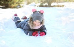 Child playing on the snow in winter day Royalty Free Stock Photography