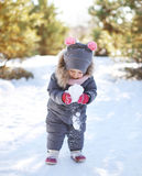 Child playing with snow in winter day Royalty Free Stock Photography