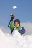 Child playing snowballs Stock Images
