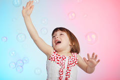 Child playing with soap bubbles Stock Photos