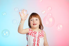 Child playing with soap bubbles Royalty Free Stock Image