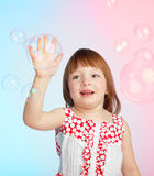 Child playing with soap bubbles Royalty Free Stock Images