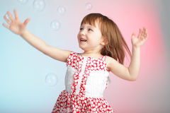Child playing with soap bubbles Stock Images