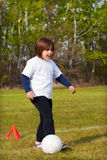 Child Playing Soccer Royalty Free Stock Photos