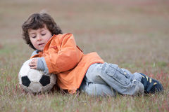 Child playing with a soccer ball Stock Photo