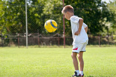 Child playing soccer ball Stock Image