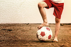 Child playing soccer on beach. Stock Photography
