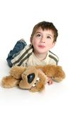 Child playing with stuffed toy Royalty Free Stock Image