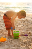 Child playing on sunset beach Stock Photos
