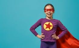 Child playing superhero stock images