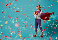 Child playing superhero royalty free stock photography