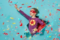 Child playing superhero stock photos