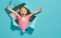 Child playing superhero royalty free stock photos