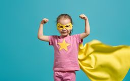Child playing superhero stock photo