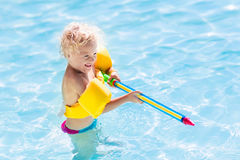 Child playing in swimming pool Royalty Free Stock Images