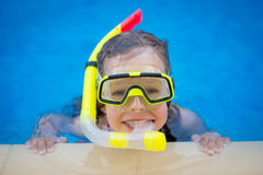 Child playing in swimming pool Royalty Free Stock Photography