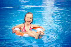 Child playing in swimming pool Stock Photography