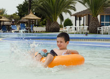 Child playing in swimming pool Stock Image
