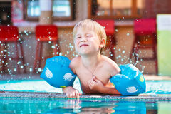 Child playing in the swimming-pool Stock Photos