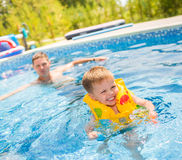 Child playing in swimming pool Stock Photos