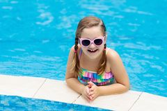 Child in swimming pool. Summer vacation with kids stock image