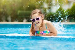 Child in swimming pool. Summer vacation with kids stock photos