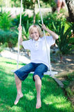 Child playing with a swing Stock Images