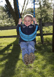Child playing on swing Stock Photos