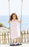 Child playing swing on vacation Royalty Free Stock Photo