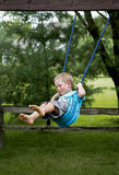 Child playing on a swing Royalty Free Stock Image