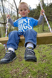 Child playing on swing Royalty Free Stock Photo