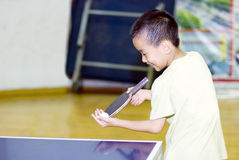 A child playing table tennis. A chinese child playing table tennis Royalty Free Stock Photo