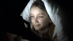 Child Playing Tablet in Dark Night, Girl Browsing Internet in Bed, Not Sleeping stock video
