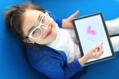 Child playing with tablet Stock Photos