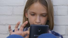 Child Playing Tablet, Kid Browsing Smartphone Online, Girl Searching Internet stock photos