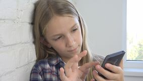 Child Playing Tablet, Kid Browsing Smartphone Online, Girl Searching Internet.  stock image