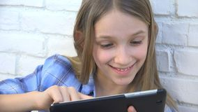 Child Playing Tablet, Kid Smartphone, Girl Reading Messages Browsing Internet royalty free stock photos