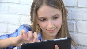 Child Playing Tablet, Kid Smartphone, Girl Reading Messages Browsing Internet stock images