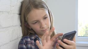 Child Playing Tablet, Kid Smartphone, Girl Reading Messages Browsing Internet stock image
