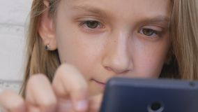 Child Playing Tablet, Kid Smartphone, Girl Reading Messages Browsing Internet stock photos