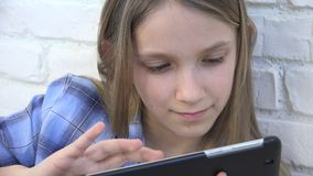 Child playing tablet, kid smartphone, girl reading messages browsing internet.  stock footage
