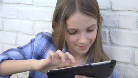 Child playing tablet, kid smartphone, girl reading messages browsing internet.  stock video footage