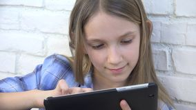Child Playing Tablet, Kid Smartphone, Girl Reading Messages Browsing Internet stock footage