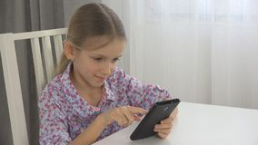 Child Playing Tablet, Kid uses Smartphone Interior View, Little Girl Texting Pad stock photo